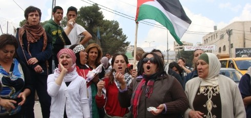 Palestinian women protest at Qalandia (photo: Mya Guarnieri)