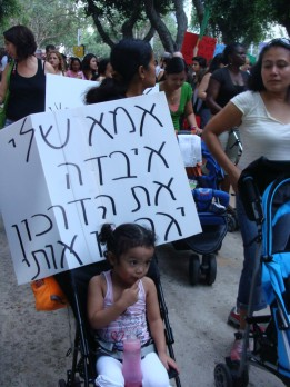 "Protest against arbitrary criteria for naturalization set in 2010. The sign reads, ""My mom lost her passport; they will deport me."" (Photo: Mya Guarnieri)"