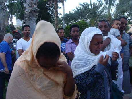 Eritreans mourn photo by Mya Guarrnieri