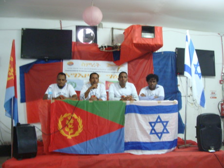 Tesfu Atsbha speaks at Eritrean community center in south Tel Aviv Israel (photo by Mya Guarnieri)
