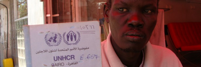 South Sudanese asylum seeker with his UNHCR papers (photo: Mya Guarnieri)